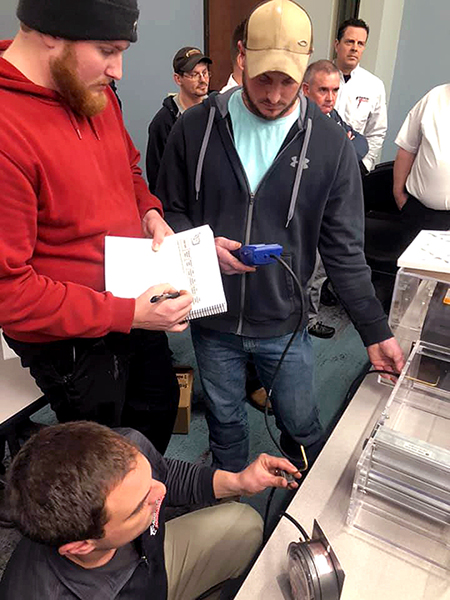 Technicians get hands-on system performance training at a Columbus, OH HVAC contracting firm.
