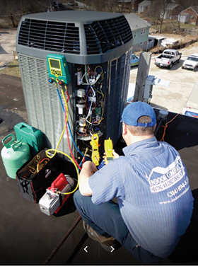 ICT Technician checking refrigerant charge