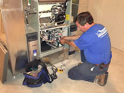 ICT Technician tests a residential furnace.
